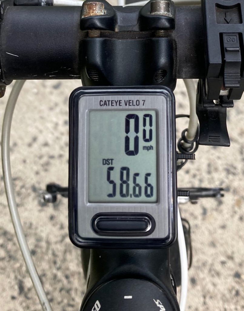 Odometer showing mileage of fifty-eight point six six.