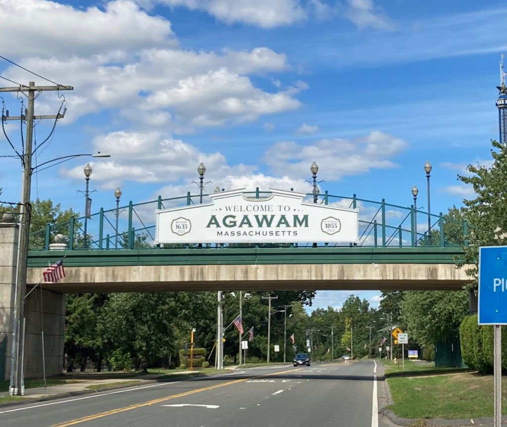 "Sign on pedestrian bridge over road that reads ""Welcome to Agawam Massachusetts"""