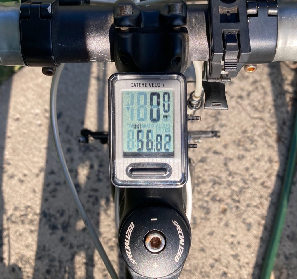 Bicycle odometer reading fifty-six point eight two miles.